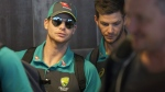 Australian cricket captain Steve Smith, left, arrives with teammates, at the Cape Town International airport to depart to Johannesburg for the final five day cricket test match on  March 27, 2018. (Halden Krog / AP)