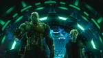 """This cover image released by Warner Bros. Pictures shows characters Aech, left, and Parzival in a scene from """"Ready Player One,"""" a film by Steven Spielberg. (Warner Bros. Pictures via AP)"""