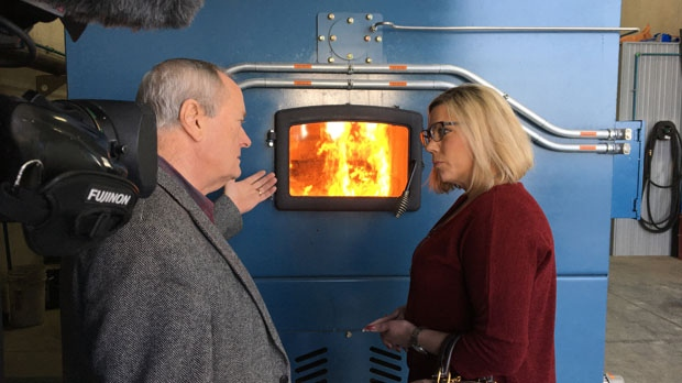 On Tuesday, the community invited Minister of Sustainable Sevelopment Rochelle Squires to take a tour of its biomass furnace. (Kraig Krause/CTV News)