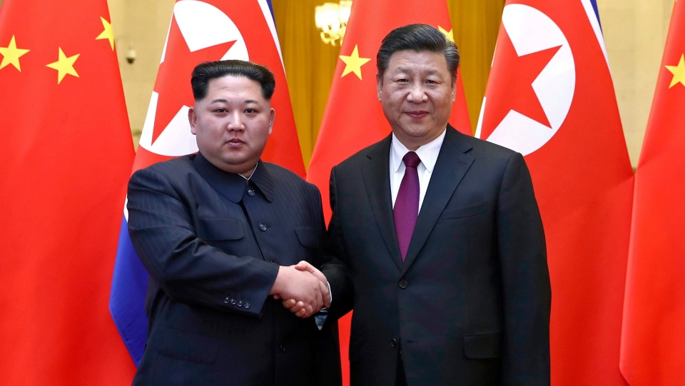 In this photo provided Wednesday, March 28, 2018, by China's Xinhua News Agency, North Korean leader Kim Jong Un, left, and Chinese President Xi Jinping shake hands in Beijing, China. (Ju Peng/Xinhua via AP)