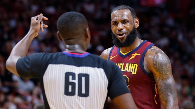 d304f22e9 Cleveland Cavaliers forward LeBron James (23) argues a call with referee  James Williams in the fourth quarter of play against the Miami Heat during  an NBA ...