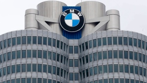 The logo of German car manufacturer BMW visible at the headquarters during the earnings press conference in Munich, Germany, Wednesday, March 21, 2018. (AP Photo/Matthias Schrader)