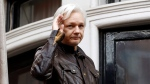 In this May 19, 2017 file photo, WikiLeaks founder Julian Assange greets supporters from a balcony of the Ecuadorian embassy in London. (AP Photo/Frank Augstein, File)