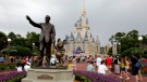 In this Tuesday, June 5, 2012, file photo, visitors stroll along Main Street at Walt Disney World, in Lake Buena Vista, Fla. (AP Photo/John Raoux, File)