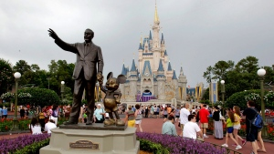 In this Tuesday, June 5, 2012, file photo, visitors stroll along Main Street at Walt Disney World, in Lake Buena Vista, Fla. (AP Photo/John Raoux, File)