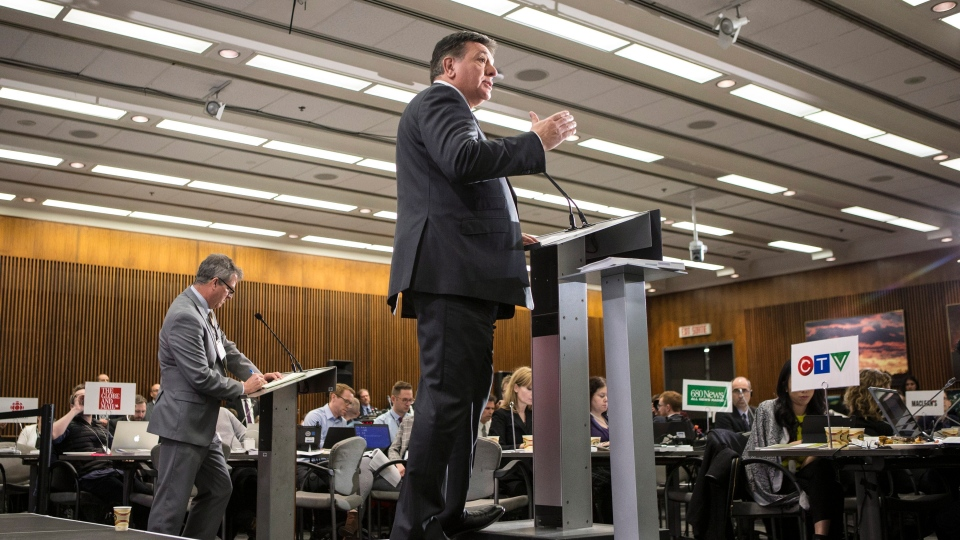 Provincial Finance Minister Charles Sousa takes questions from journalists during a pre-budget lock-up as the Ontario Provincial Government prepares to deliver its 2018 Budget at the Queens Park Legislature in Toronto on March 28, 2018. THE CANADIAN PRESS/Chris Young