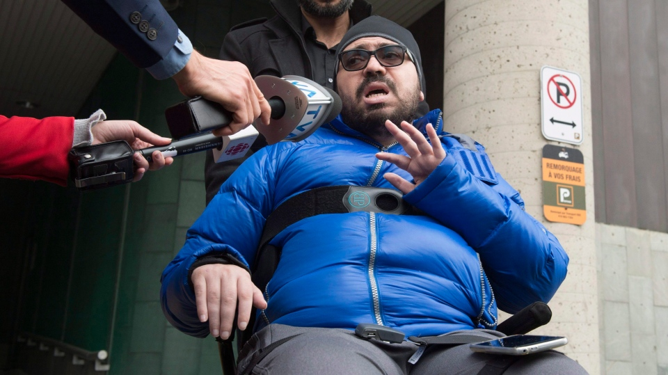 Aymen Derbali reacts to the guilty plea by Alexandre Bissonnette for the 2017 mosque shooting, Wednesday, March 28, 2018 at the hall of justice in Quebec City. Derbali was injured during the shooting and has been paralyzed since. THE CANADIAN PRESS/Jacques Boissinot