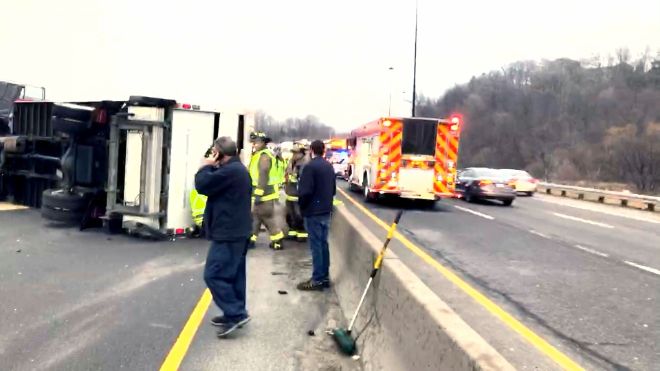 A flipped truck causes major delays on the DVP on March 29, 2018.