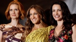"""In this March 18, 2010 file photo, actresses Sarah Jessica Parker, center, Cynthia Nixon, left, and Kristin Davis, from the upcoming film """"Sex and the City 2,"""" pose for photographers at the Warner Bros. Pictures photo call during ShoWest 2010 in Las Vegas. (Matt Sayles/AP Photo)"""