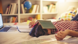 Students who take classes at a time which doesn't fit with their own biological clock may suffer from poorer grades, according to new research. (svetikd/Istock.com)