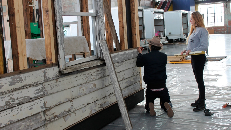 In this March 28, 2018 photo, artist Ryan Mendoza and his wife, Fabia Mendoza, put up siding, in Providence, R.I., on a house where Rosa Parks sought refuge after fleeing the South. (AP Photo/Michelle R. Smith)