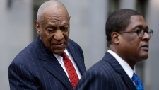 Bill Cosby, left, arrives for a pretrial hearing