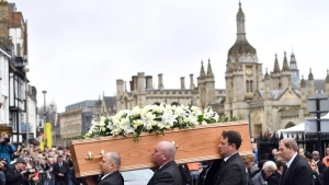 The coffin of Professor Stephen Hawking arrives at University Church of St Mary the Great as mourners gather to pay their respects, in Cambridge, England, Saturday March 31, 2018. (Joe Giddens/PA via AP)