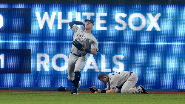 Tanaka throws six scoreless as Yankees top Jays, 4-2