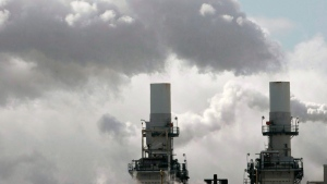 Steam spills out of smoke stacks at a building in Toronto, Friday, Feb. 18, 2005. Air pollution cost Canadian families an estimated $36 billion in 2015 due to premature death and illness, a new research report says. THE CANADIAN PRESS/Adrian Wyld