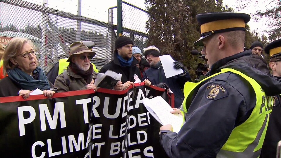 Federal Green Party Leader Elizabeth May stands with protesters before she arrested outside Kinder Morgan's facility in Burnaby, B.C., on Friday March 23, 2018.