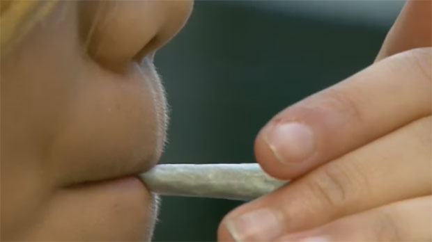 A woman lights up a joint in this file photo.