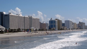 In this May 22, 2013 file photo, vacationers enjoy the beach in Myrtle Beach, S.C. (AP Photo/Bruce Smith, File)