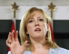 Natural Resources Minister Lisa Raitt responds to questions during a news conference after announcing that the Harper government plans to sell off parts of Atomic Energy of Canada Limited, in Ottawa, Thursday May 28, 2009. (Fred Chartrand / THE CANADIAN PRESS)