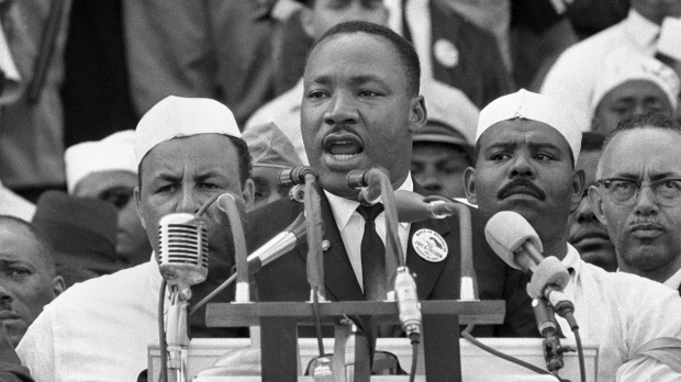 "Dr. Martin Luther King Jr., head of the Southern Christian Leadership Conference, addresses marchers during his ""I Have a Dream"" speech at the Lincoln Memorial in Washington, Aug. 28, 1963. (AP Photo)"