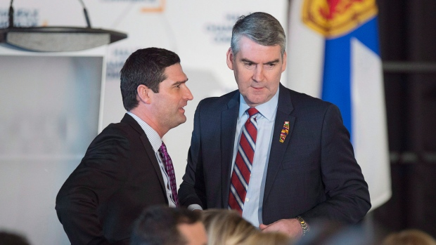 Premier Stephen McNeil, right, chats with Geoff MacLellan, government house leader, before he delivers the state-of-the-province speech at a business luncheon in Halifax on February 7, 2018. (THE CANADIAN PRESS/Andrew Vaughan)