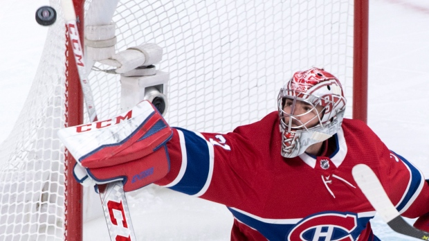 Montreal Canadiens goaltender Carey Price deflects a shot as they play the Winnipeg Jets during second period NHL hockey action Tuesday, April 3, 2018 in Montreal. THE CANADIAN PRESS/Paul Chiasson