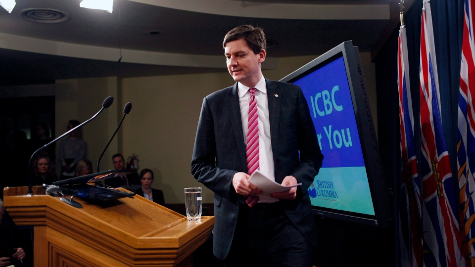 Attorney General David Eby arrives to speak about changes to ICBC during a press conference in the press gallery at Legislature in Victoria, B.C., on Tuesday February 6, 2018. THE CANADIAN PRESS/Chad Hipolito