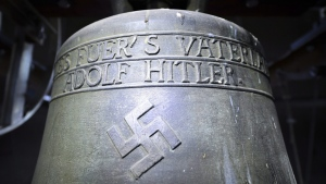 A church bell with the inscription 'Everything for the fatherland Adolf Hitler' and a swastika is pictured in the town church in Herxheim am Berg, western Germany, on May 19, 2017. (Uwe Anspach/dpa via AP)