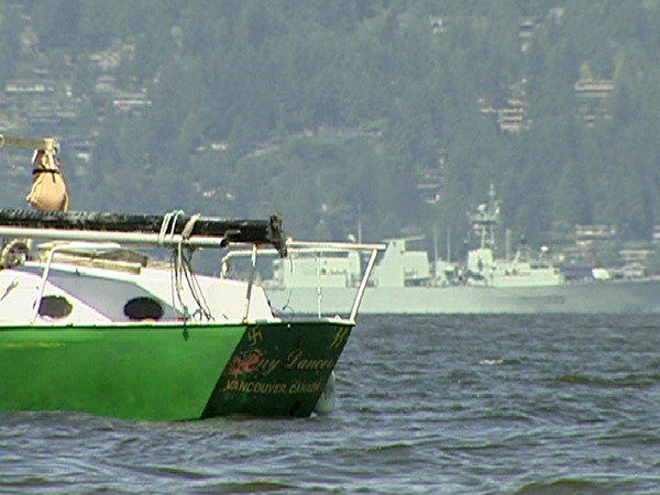 A sailor anchored outside Jericho Beach in Vancouver, allegedly painted Nazi symbols on his boat to protest the city's efforts to force him to relocate. May 29th, 2009.