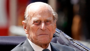 FILE - In this file photo dated Wednesday, July 12, 2017, Britain's Prince Philip sits in a carriage in London. (AP Photo/Matt Dunham, FILE)