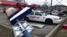A taxi sustained damaged after a KFC sign fell in a wind storm. (David Ritchie)