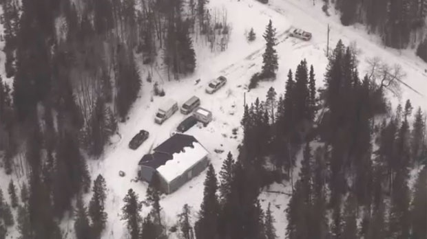 Emergency response vehicles on the property of a Stoney Nakoda First Nation residence following the death of a child on April 4, 2018