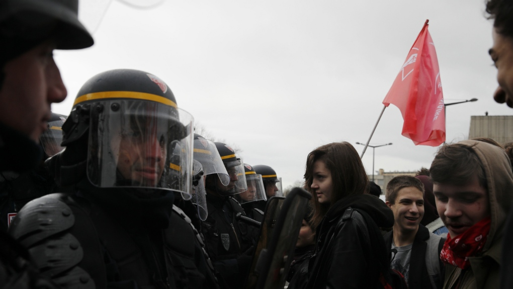 Students face off against riot police in France