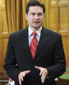 Pierre Poilievre, parliamentary secretary to the prime minister, speaks during question period, in Ottawa, on Friday, May 29, 2009. (Fred Chartrand / THE CANADIAN PRESS)