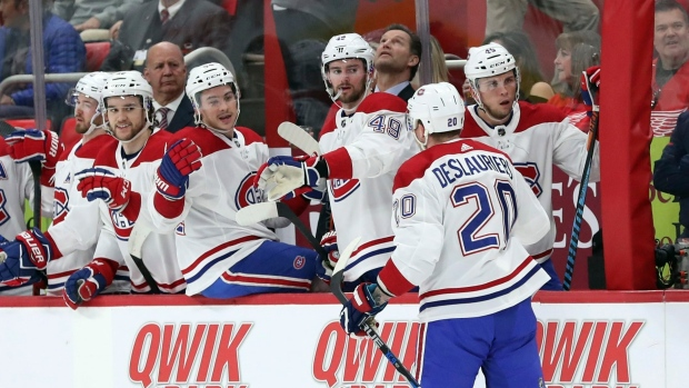 Montreal Canadiens left wing Nicolas Deslauriers is congratulated by teammates after his goal during the first period of an NHL hockey game against the Detroit Red Wings, Thursday, April 5, 2018, in Detroit. (AP Photo/Carlos Osorio)