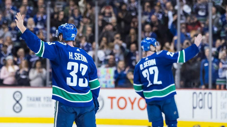 53b80c16854 Vancouver hockey fans bid fond farewells to retiring Sedin twins ...