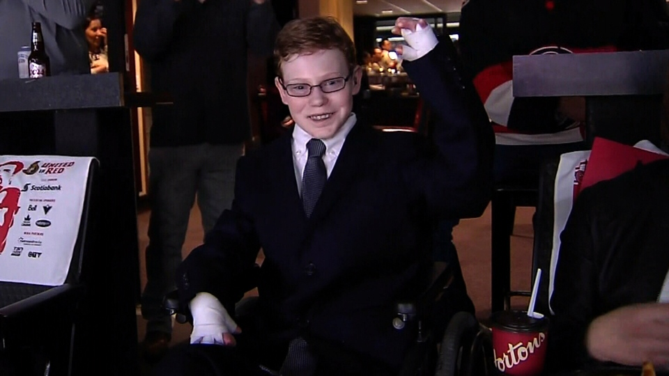 Jonathan Pitre, known as the 'Butterfly Boy', at an Ottawa Senators game.