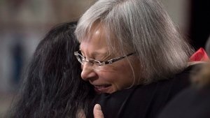 Chief Commissioner Marion Buller gives Catherine Mills a hug following her testimony during the National Inquiry of Missing and Murdered Indigenous Women and Girls in Richmond, B.C., Wednesday, April, 4, 2018. (THE CANADIAN PRESS/Jonathan Hayward)