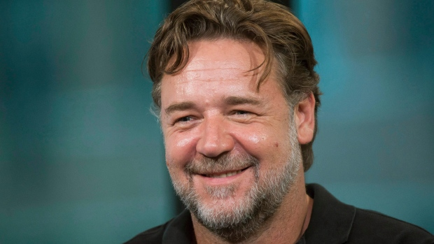 Piers Morgan secretly bids on two major items from Russell Crowe's 'Art of Divorce' auction -spending $14500 on a