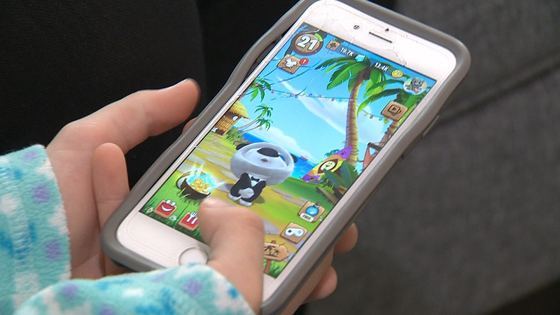 An Edmonton mom said her 10-year-old daughter racked up more than $4,800 in in-app purchases, while playing an iPhone game called 'My Talking Hank'.