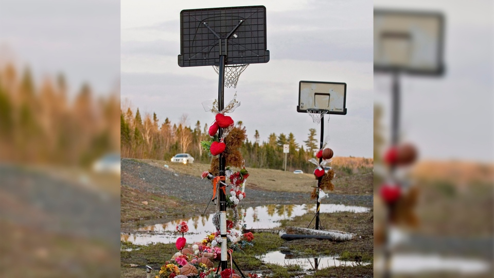 A makeshift basketball court marks the site of a van crash that took the lives of seven high school basketball players and a teacher 16 months ago, on the outskirts of Bathurst, N.B. on Sunday, May 3, 2009. THE CANADIAN PRESS/Andrew Vaughan