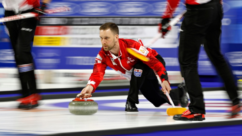 FILE - Canada skip Brad Gushue, center, delivers a stone against Sweden during the World Men's Curling Championship, April 6, 2018, in Las Vegas. (AP Photo/John Locher)
