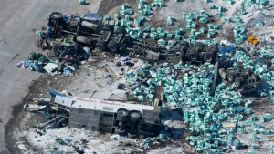 The wreckage of a fatal crash outside of Tisdale, Sask., is seen Saturday, April, 7, 2018. A bus carrying the Humboldt Broncos hockey team crashed into a truck en route to Nipawin for a game Friday night killing 14 and sending over a dozen more to the hospital. THE CANADIAN PRESS/Jonathan Hayward