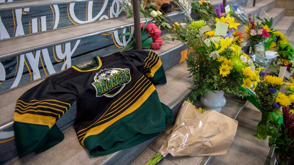 A memorial at the stairs that lead to Elgar Petersen Arena is shown in Humboldt, Sask., on Saturday, April 7, 2018. (THE CANADIAN PRESS/Liam Richards)