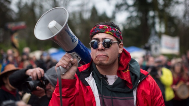 Cedar George-Parker pauses while addressing the crowd as protesters opposed to the Kinder Morgan Trans Mountain pipeline extension defy a court order and block an entrance to the company's property, in Burnaby, B.C., on Saturday April 7, 2018. (THE CANADIAN PRESS/Darryl Dyck)