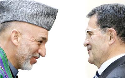 Italian Premier Romano Prodi welcomes Afghan President Hamid Karzai at Rome's Palazzo Chigi Premier office. (AP / Alessandra Tarantino)