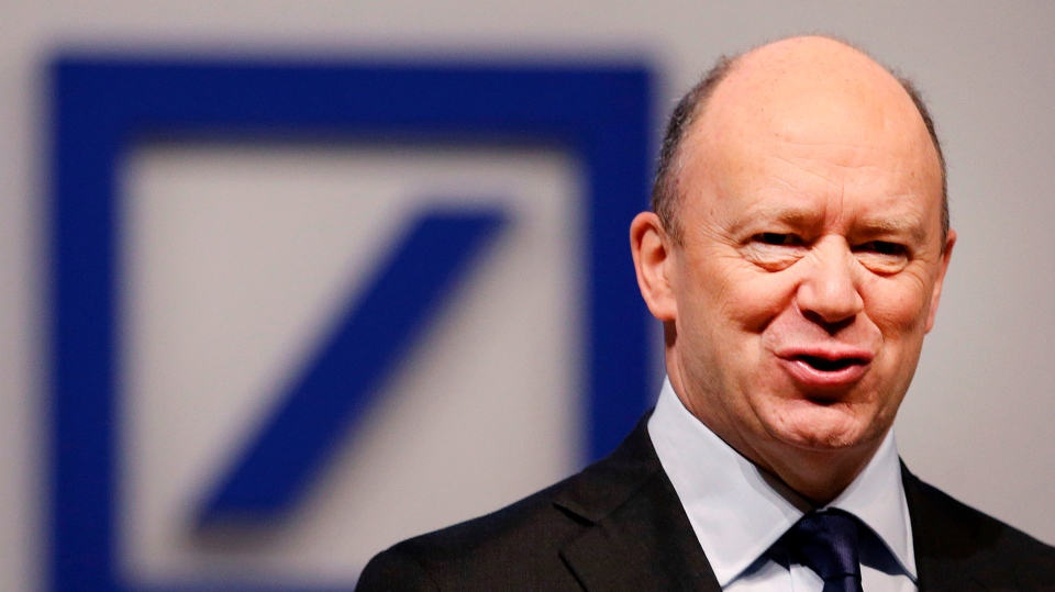 In this May 18, 2017 file photo, CEO of Deutsche Bank John Cryan poses for photographers at the beginning of the bank's annual shareholders meeting in Frankfurt, Germany. (AP Photo/Michael Probst)