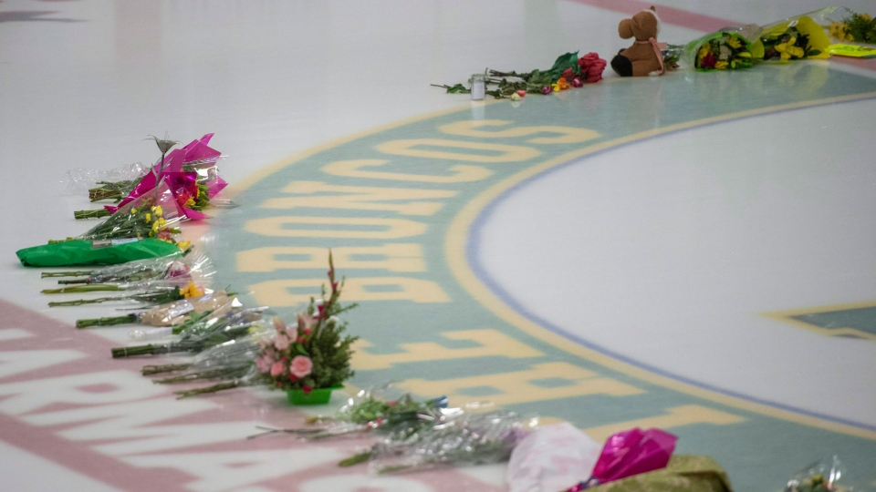 Flowers are shown at centre ice as preparations are made at Elgar Petersen Arena for a vigil tonight in Humboldt, Sask., Sunday, April 8, 2018. 15 people traveling with the Humboldt Broncos SJHL hockey team are dead, and many injured when their bus was collided with a semi-trailer 30 kilometres north of Tisdale, Sask. THE CANADIAN PRESS/Liam Richards