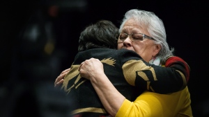 Rita Blind, right, sheds tears while embracing Viola Thomas after listening to Bernie Williams testify at the final day of hearings at the National Inquiry into Missing and Murdered Indigenous Women and Girls, in Richmond, B.C., on Sunday April 8, 2018. (THE CANADIAN PRESS/Darryl Dyck)
