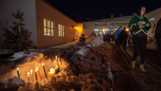 Community members leave a vigil at the Elgar Petersen Arena, home of the Humboldt Broncos, to honour the victims of a fatal bus accident in Humboldt, Sask. on Sunday, April 8, 2018. THE CANADIAN PRESS/Liam Richards